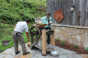 Grind and press apple juice into delicious cider. Manual labor of love!