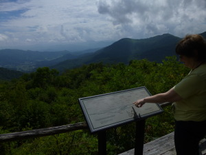 Barb looks over a map of some of the Smoky Mountain Range.