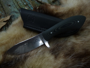 This Sendero Bush Knife is not a whittler, but you can shave with it and of course skin anything! One tough, hand-friendly knife!