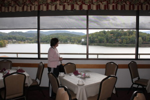 Barb looking out at the lake from the Terrace Dining Room where we took all our fine, buffet meals. The views made us hungry for more!