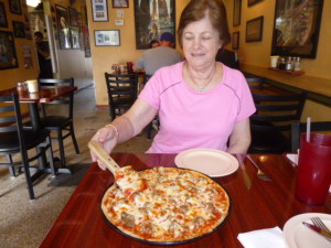 Barb is digging in to a Chicago sausage pizza!